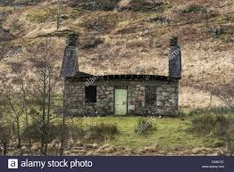 Small Cottage by Small Stone Cottage In Glen Fyne In The Scottish Highlands The