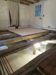 an old farm laying a subfloor on old beams
