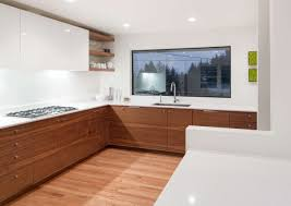 high gloss white grain matched walnut cabinets white countertop
