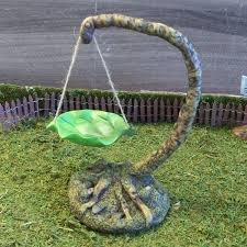garden leaf swing and tree stand sculpted tree
