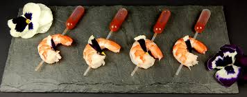 pipette cuisine shrimps with cocktail sauce in pipette molecular recipes