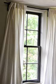 between blue and yellow october 2014 finally i came across a blog don t remember which one that showed how you can use a bendable curtain rod from ikea to make a bay window rod here is what