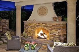 Stacked Stone Outdoor Fireplace - enhance your outdoor living with unique and inviting fire features