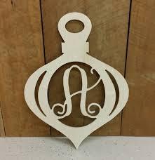 unpainted wooden ornament door hanger with connected initial