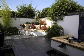 backyard outdoor garden with corner seating space complete with