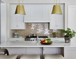 white kitchen cabinets with taupe backsplash taupe subway tiles with white cabinets transitional kitchen