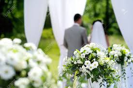 white flowers decorations during outdoor wedding ceremony stock