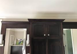 how do you fill the gap between kitchen cabinets and ceiling how to fill space between cabinets and ceiling caroline on