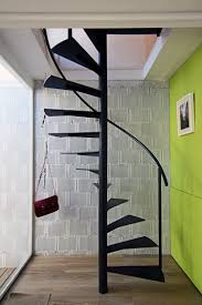 marvellous spiral staircase design with black iron materials added