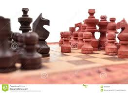 wooden chess pieces on a chess board is unique royalty free stock