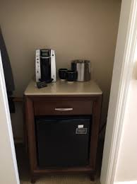 fridge and coffee maker in bedroom picture of hotel santa