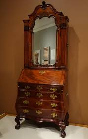 file desk and bookcase behind mirror possibly by thomas