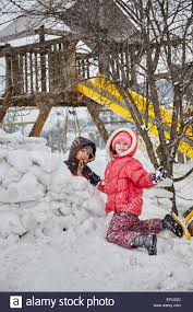 children playing in a snow fort in crozet virginia stock photo