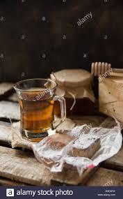 cup of herbal tea jar with honey dipper spanish christmas
