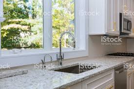 stove top kitchen cabinets interior of modern kitchen with appliances on stove top marble counter with kitchen white cabinets stock photo image now