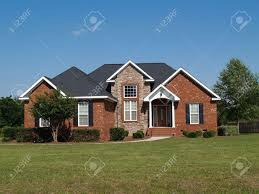 one story new stone and brick residential home stock photo