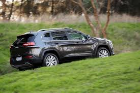 green jeep cherokee 2014 2014 jeep cherokee pricing and specifications photos 1 of 17