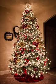 christmas tree with white lights and red bows pin by amanda olbera rodriguez on christmas tree pinterest