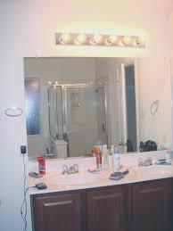bathroom view installing bathroom light fixture over mirror home