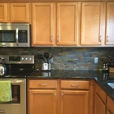 light wood kitchen cabinets with countertops grey countertops and wood cabinets how to make it work