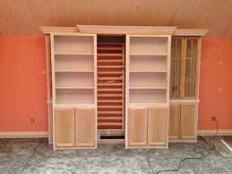 sliding bookcase murphy bed 36 diy sliding bookcase wood brown farmhouse barn door bookcase