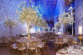 reception décor photos wintry white centerpieces blue lighting