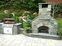 outdoor fireplace stone standard outdoor fireplace with natural stone veneer sits alongside a stainless prefab outdoor