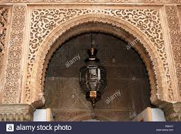 morroco style moorish archway and moroccan style light palace of alhambra stock