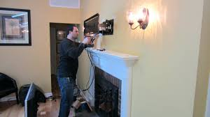 install tv fireplace over wiring installation on brick interior
