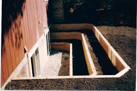 exterior design chic egress window wells with wood retaining wall