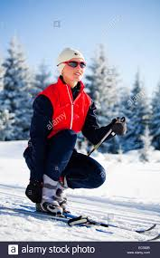 a woman runing cross country ski skate style stock photo royalty