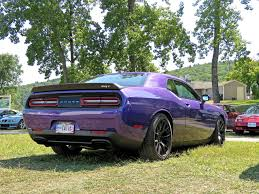 badass challenger this purple challenger hellcat is a rolling middle finger aimed at