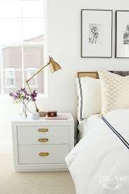 white night table w gold handles gold desk lamp white bed linens