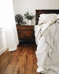 floors decor and more relaxed neutral bedroom with wooden floors wooden furniture
