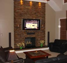 great room modern living room with stone fireplace and in glass