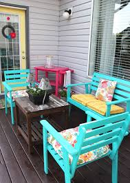 cheery and bright summer patio love the aqua chairs and pops of