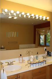 bathroom purple rectangle glass lights above mirror rustic