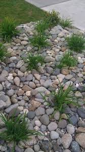 replace front yard flower beds with river rock home decor ideas