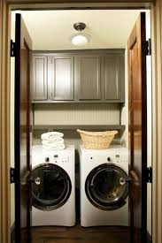 washer and dryer cabinets cabinets over washer dryer transitional laundry room twin