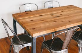 wood and metal dining table combined industrial style chairs of