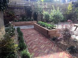 modern victorian garden brick walls herring bone brick path oak