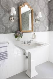 how i painted our bathroom s ceramic tile floors a simple and love this bathroom makeover with stenciled walls that look like wallpaper wood medicine cabinet