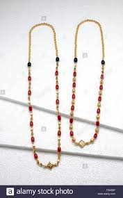 black gold necklace jewelry images Gold jewellery necklace with gold beads coral stones and black jpg