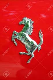ferrari logo ferrari logo on a car stock photo picture and royalty free image