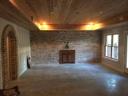 tongue and groove cedar ceiling with reclaimed brick accent wall
