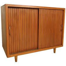 Slide Door Cabinet Mid Century Modern Sliding Door Cabinet At 1stdibs
