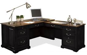 l shaped black wooden desk with brown wooden top and some drawers magnetizing