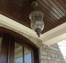 Exterior Beadboard Porch Ceiling - dark stained beadboard on the ceiling of covered patio making a