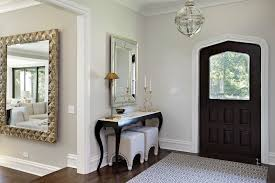 narrow console table in entry transitional with wood front door