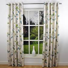 twin white fabric curtains with green and blue leaves pattern for